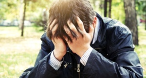 Sad-man-covering-his-face-with-his-hands-Shutterstock-800x430
